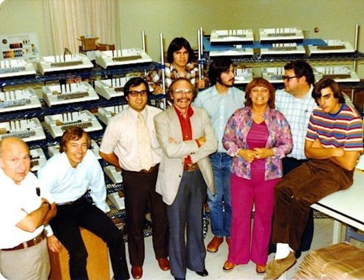 L-to-R Elmer Baum Mike Markkula Gary Martin Andre Sousan Steve Jobs Sue Cabannis Mike Scott and Don Breuner e in the rear Mark Johnson.jpg